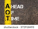 Small photo of Concept image of Business Acronym AOT Ahead Of Time written over road marking yellow paint line