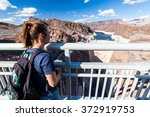 girl in front of hoover dam and ... | Shutterstock . vector #372919753
