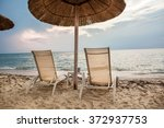 thatched beach umbrellas beds   Shutterstock . vector #372937753