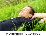 young man relaxing in spring... | Shutterstock . vector #37295038