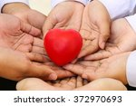 many hands and a red heart as a ... | Shutterstock . vector #372970693