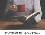 young woman reading a book and... | Shutterstock . vector #373019677