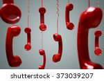 Red telephone receiver hanging...