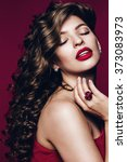 Small photo of Hair, hairstyle, healthcare, make up. Hot beautiful woman with claret lips and dress