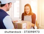 view of a delivery man handing... | Shutterstock . vector #373098973