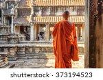 buddhist monk looking at...   Shutterstock . vector #373194523