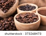 Ground Coffee And Coffee Beans...