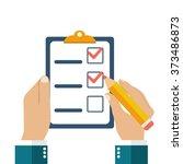 businessman holding checklist... | Shutterstock .eps vector #373486873