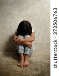 sad little girl sitting near... | Shutterstock . vector #373506763