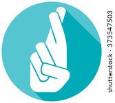 hand with crossed fingers flat... | Shutterstock .eps vector #373547503