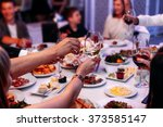 hands of people with glasses of ... | Shutterstock . vector #373585147