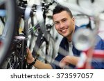 Technician Fixing Bicycle In...