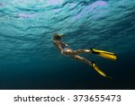 Lady Swimming Underwater In A...