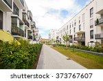 modern residential buildings... | Shutterstock . vector #373767607
