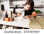 Seamstress Sews Clothes And Pu...