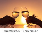 cheers against a sunset.    Shutterstock . vector #373973857