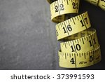 rolled yellow tape measure | Shutterstock . vector #373991593