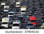 red car in big urban traffic   Shutterstock . vector #37404133
