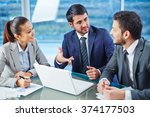 consulting with colleague | Shutterstock . vector #374177503