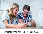 focused couple using smartphone ... | Shutterstock . vector #374201563