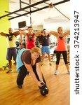 fat woman fails to lift up... | Shutterstock . vector #374213947