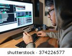 concentrated young hacker in... | Shutterstock . vector #374226577