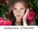 beautiful woman with a rose   Shutterstock . vector #374262337