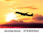 airplane taking off at sunset.... | Shutterstock . vector #374303563