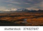 Snowcapped Mountain Peaks Abov...