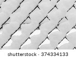 chain link fence with snow.... | Shutterstock . vector #374334133