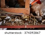 Small photo of Rusty nuts and bolts in disarray on a shelf