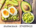 toast with avocado and egg on... | Shutterstock . vector #374399413