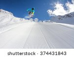 flying snowboarder on mountains.... | Shutterstock . vector #374431843