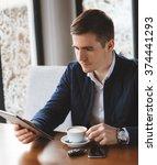 handsome man drinking coffee...   Shutterstock . vector #374441293