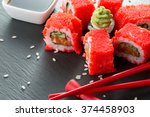 sushi rolls with red chopsticks ... | Shutterstock . vector #374458903
