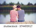 gay couple in love on river bank | Shutterstock . vector #374495917