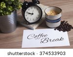 cup of coffee  clock and... | Shutterstock . vector #374533903