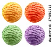 Stock photo set of four scooped balls of yellow red green and blue colored ice cream over white background 374583913