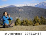 she is watching the mountains...   Shutterstock . vector #374613457