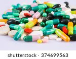 various colorful pills on white
