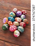 colorful easter eggs on wooden... | Shutterstock . vector #374767387