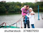 portrait of a nice family on... | Shutterstock . vector #374807053
