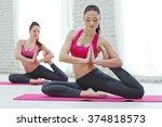 group of women doing yoga... | Shutterstock . vector #374818573