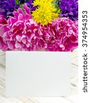 bouquet of flowers and a blank...   Shutterstock . vector #374954353