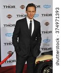 """Small photo of LOS ANGELES, CA - NOVEMBER 4, 2013: Tom Hiddleston at the US premiere of his movie """"Thor: The Dark World"""" at the El Capitan Theatre, Hollywood. Picture: Paul Smith / Featureflash"""