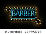 the neon sign of a barber shop