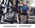 bodybuilder working out with... | Shutterstock . vector #374999587