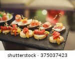 beautifully decorated catering... | Shutterstock . vector #375037423