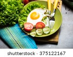 prepared breakfast with fried... | Shutterstock . vector #375122167