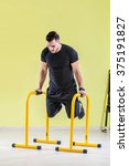 young man at gym  exercising... | Shutterstock . vector #375191827